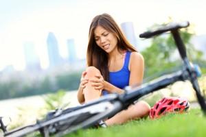 Knee pain bike injury woman