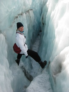 N.Z. Franz Josef Glacier Marcia Climbing in Small Crevasse with Crampons on!